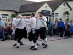 more sword dancing in motion before a pub